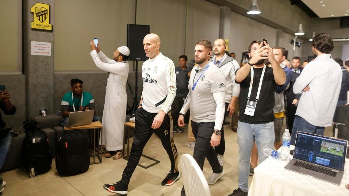 Real Madrid's head coach Zinedine Zidane arrives for a press conference in Jiddah, Saudi Arabia, on January 7, 2020. (AP)