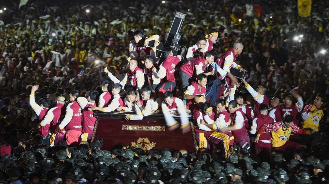 Thousands of devotees follow the carriage with the statue of the Black Nazarene at the start of an annual religious procession in Manila. (AFP)