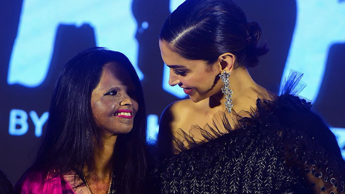Actress and producer Deepika Padukone (R) poses with acid attack survivor Laxmi Agarwal (L) during the launch of the upcoming Hindi film 'Chhapaak'. (AFP)