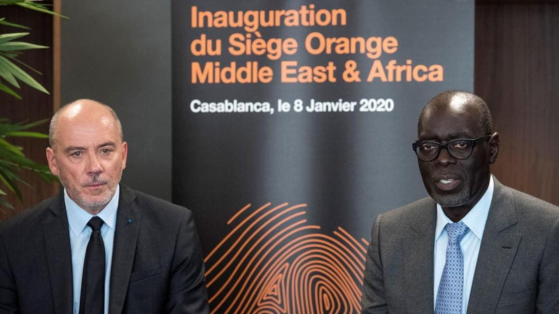 General director of the French multinational telecommunications company Orange Stephane Richard (L) and General director of Orange for Middle East and Africa Alioune Ndiaye (R) give a joint press conference during the inauguration of the Orange company headquarters for Middle East and Africa, in Casablanca, on January 8, 2020. (AFP)
