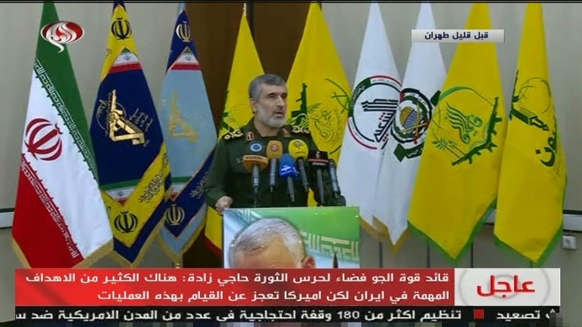 IRGC airforce commander Amir Ali Hajizadeh in front of proxy flags Iran on state TV, Jan 9 - Screengrab from Twitter