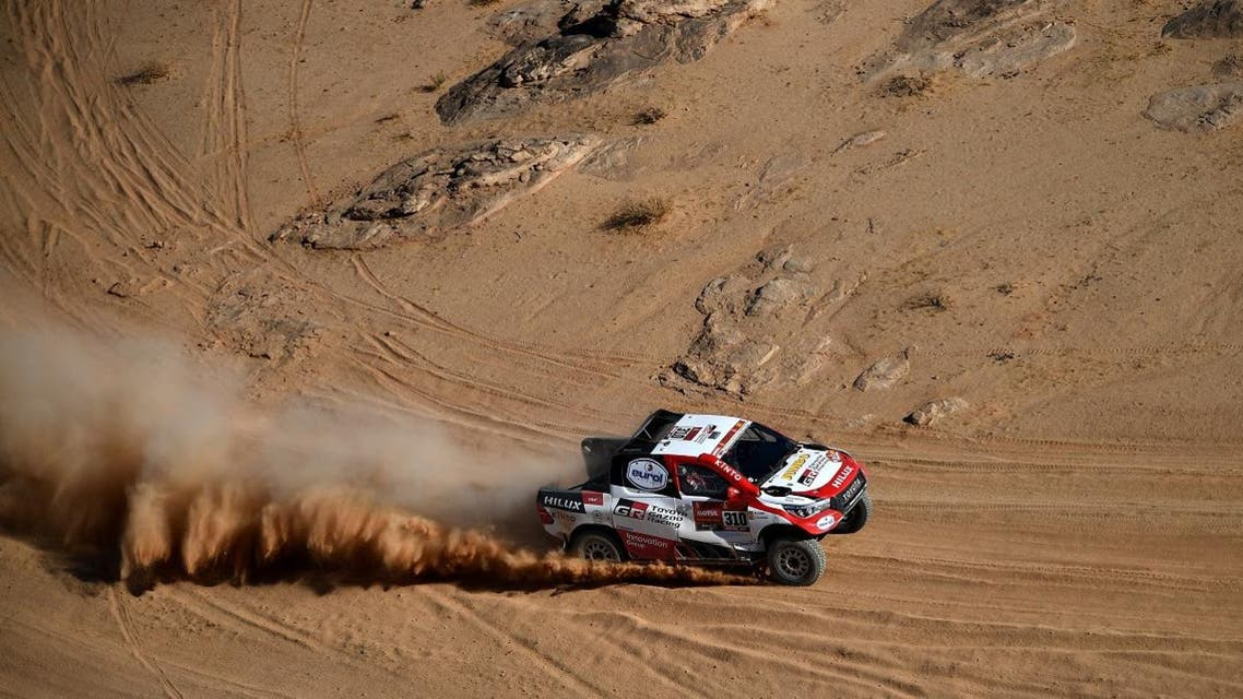 Toyota's Spanish driver Fernando Alonso and Spanish co-driver Marc Coma compete during the Stage 4 of the Dakar 2020 between Neom and Al-Ula, Saudi Arabia, on January 8, 2020. (AFP)