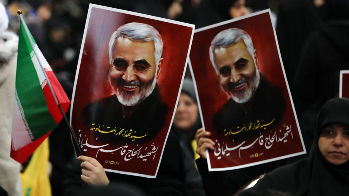 Supporters of the Shia Hezbollah movement hold posters of slain Iranian major general Qasem Soleimani, January 5, 2020. (AFP)