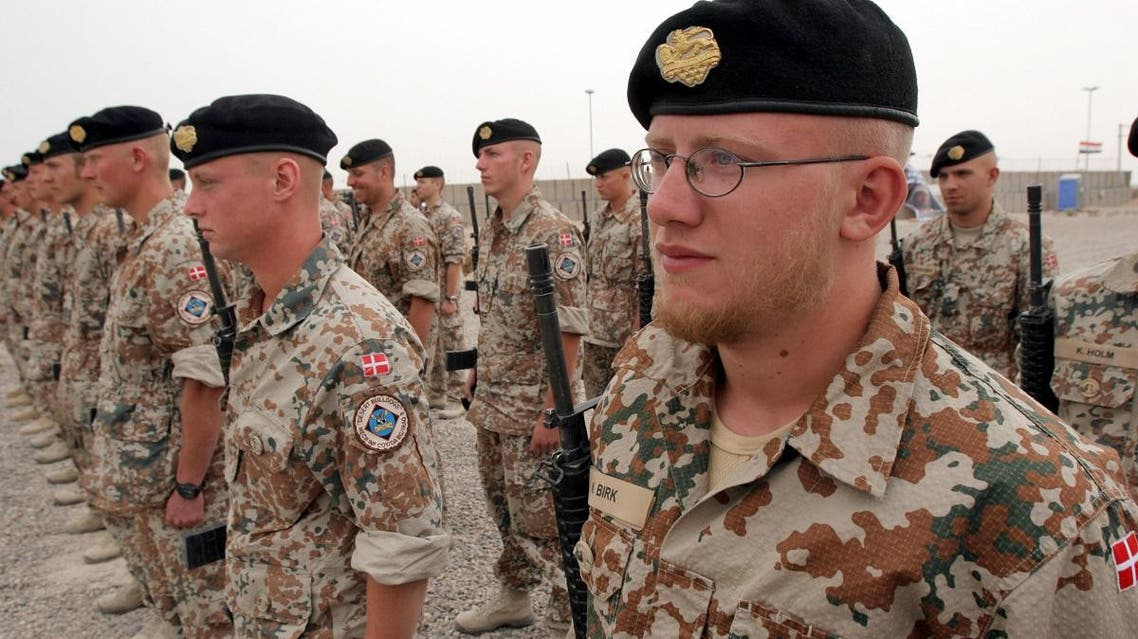 Danish soldiers stand guard during a ceremony to mark transfer of control of a British military base, in Basra, Iraq, Tuesday, April 24, 2007. (File photo: AP)