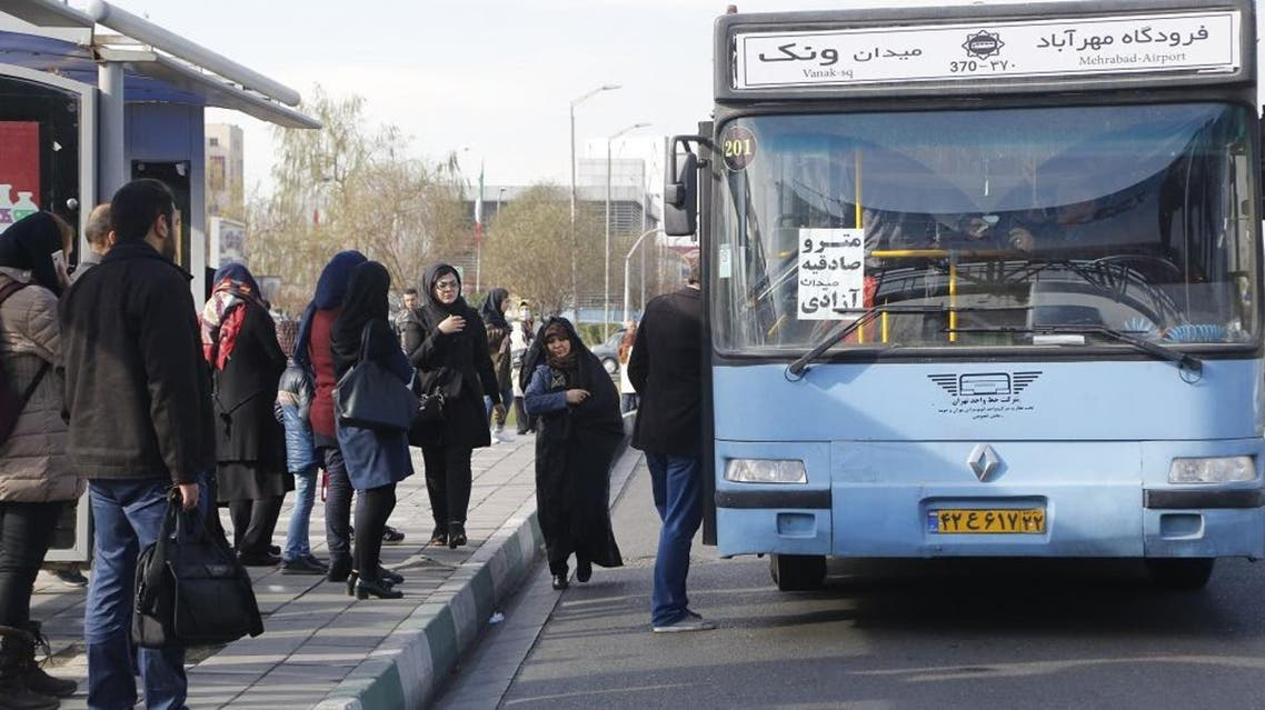 Iranians stand at a bus stop on a main road in the Islamic republic's capital Tehran. (AFP)