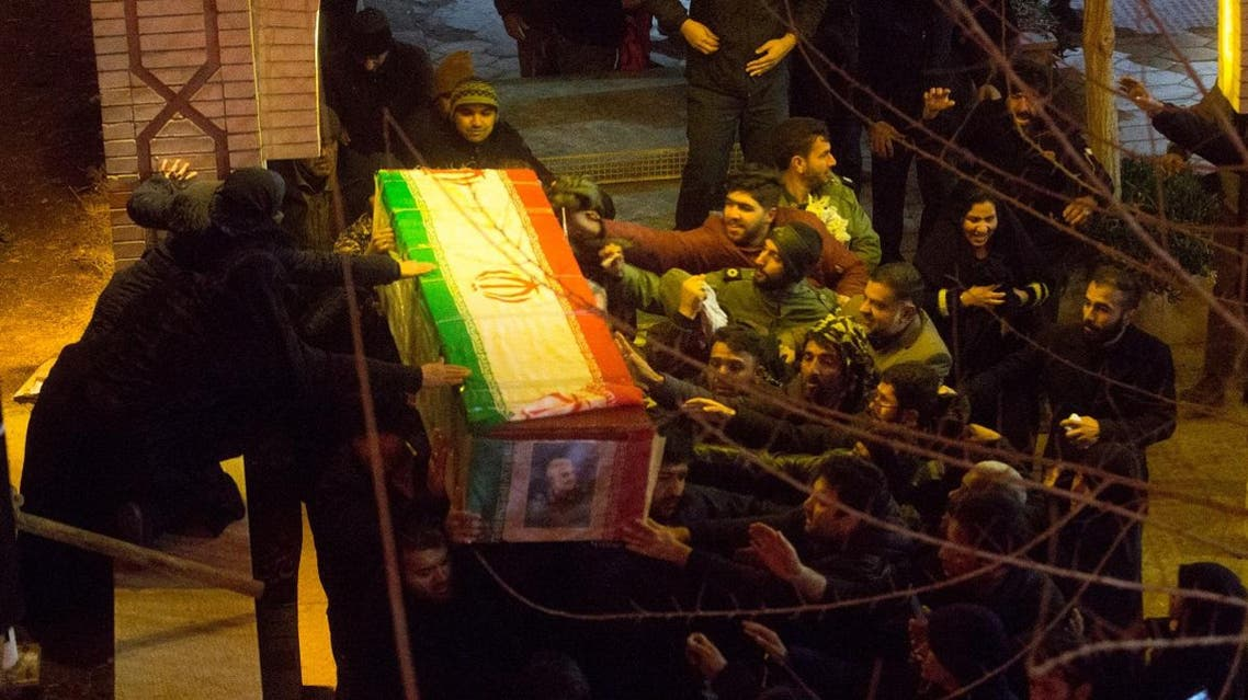 Mourners carry the coffin of Iranian Major-General and head of the elite Quds Force Qassem Soleimani, who was killed in an air strike at Baghdad airport, during the funeral at his hometown in Kerman, Iran. (Reuters)