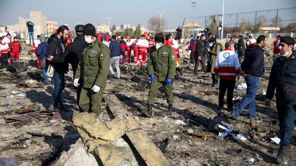 Security officers and Red Crescent workers are seen at the site where the Ukraine International Airlines plane crashed, on the outskirts of Tehran, Iran January 8, 2020. (Photo: Reuters)