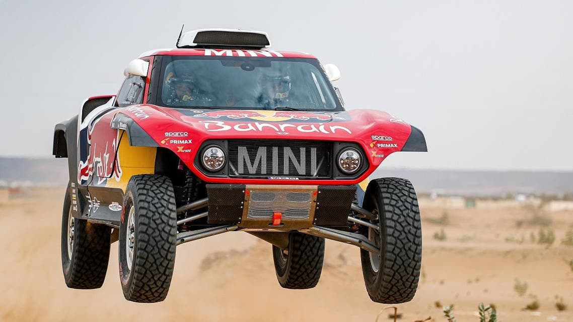 Mini's Spanish drivers Carlos Sainz of Spain and co-driver Lucas Cruz of Spain drives during a driving session on the eve of technical checkup in Jeddah. (AFP)