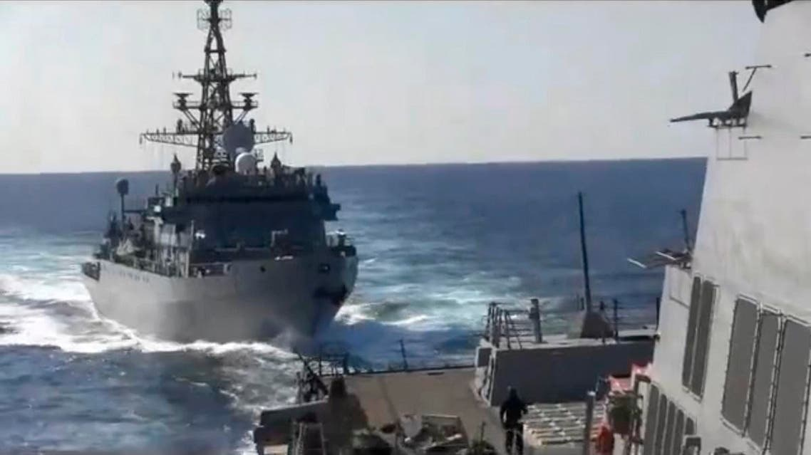 This photo provided bythe U.S. 5th Fleet, shows a Russian Navy ship approaching an American warship in the North Arabian Sea, on Thursday, Jan. 9, 2020. (AP)