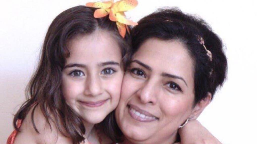 باريسا إغباليان وطفلتها البالغة من العمر 9 سنوات