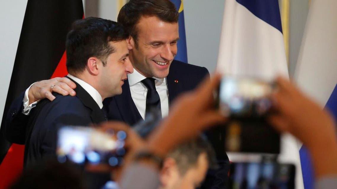 Ukraine's President Volodymyr Zelenskiy (L) and French President Emmanuel Macron. (AFP)