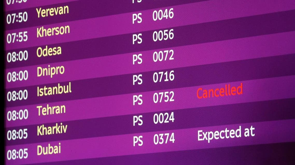 An electronic board displays information on flights including the one from Tehran marked as cancelled. (Reuters)