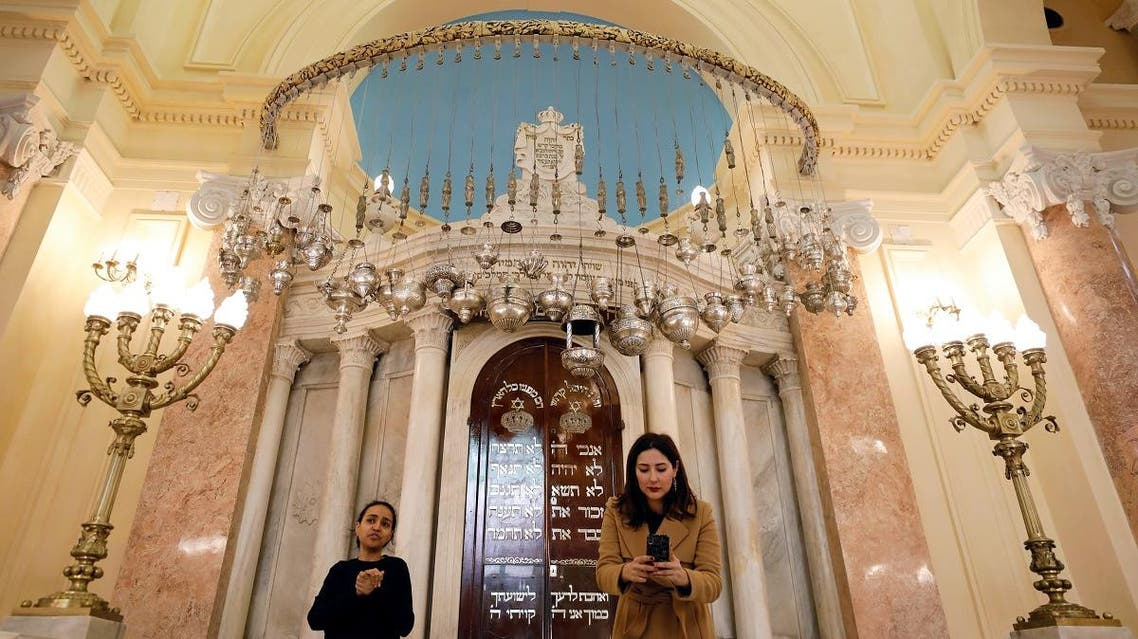 People stand in front of bima inside the Eliyahu Hanavi Synagogue during its reopening after the completion of a restoration project in Alexandria, Egypt. (Reuters)