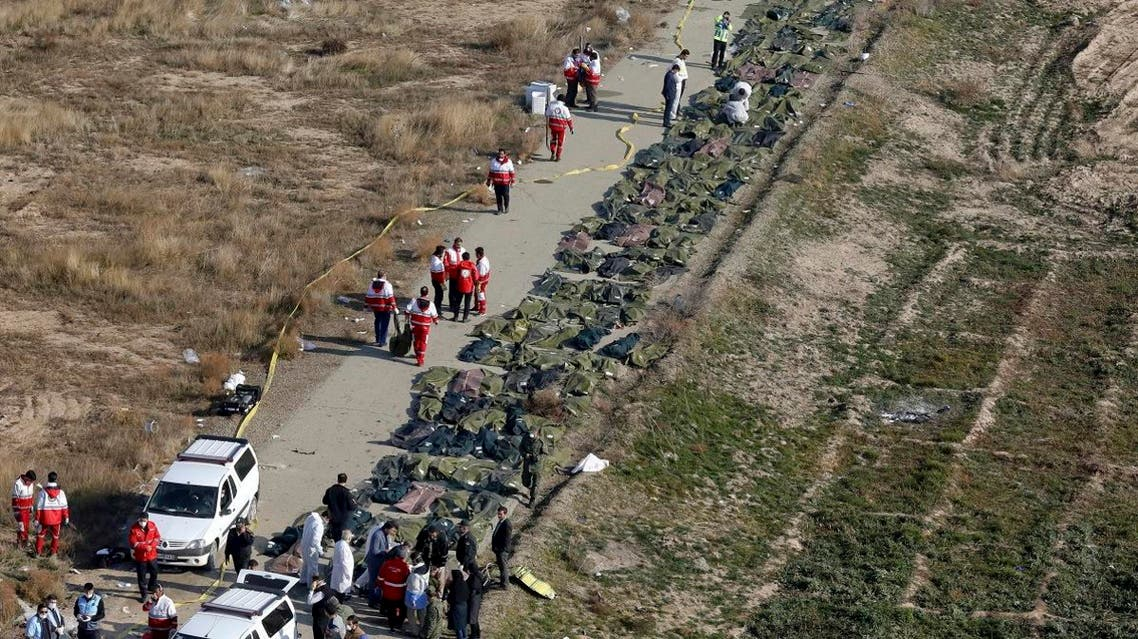 Bodies of the victims of a Ukrainian plane crash are collected by rescue team at the scene of the crash in Shahedshahr, southwest of the capital Tehran, Iran. (AP)