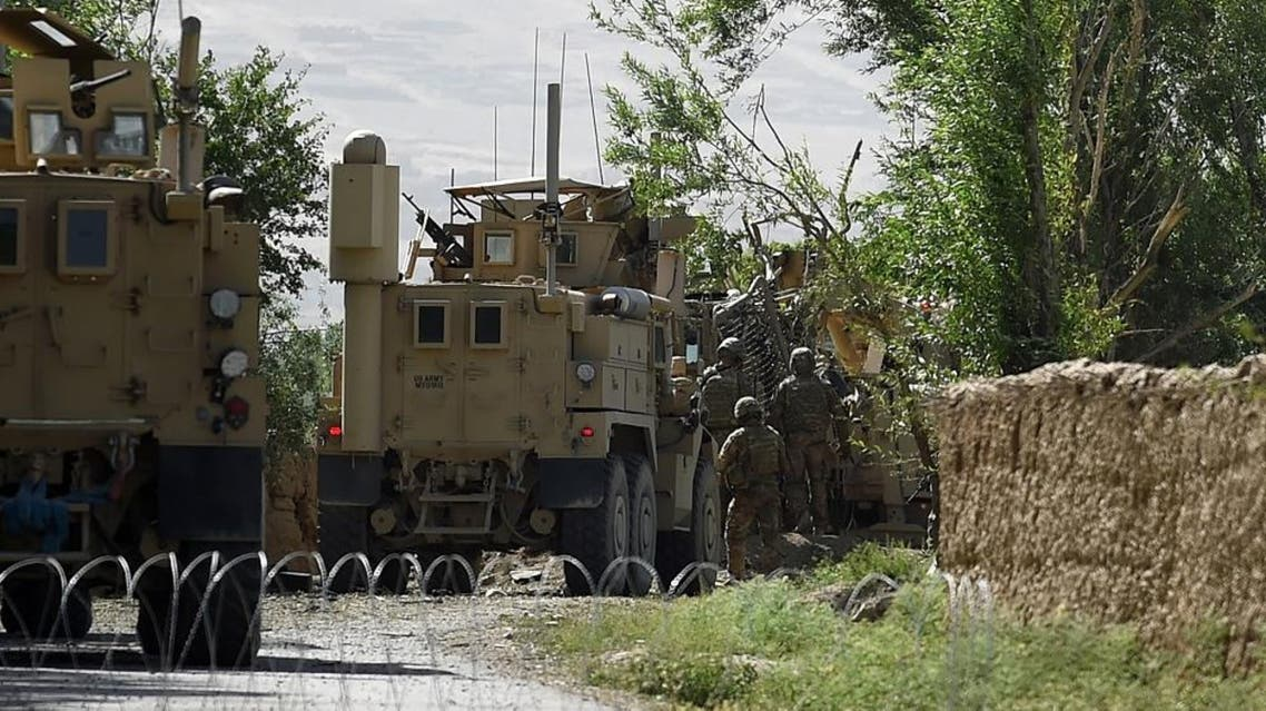 US soldiers inspect the site of a roadside bomb blast at Abed Kheel near Charikar district of Parwan. afp