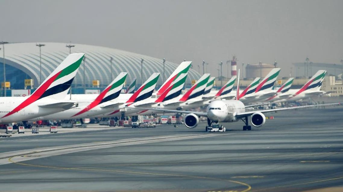 A picture take on September 14, 2017 shows Emirates planes parked at the tarmac at Dubai's International Airport. (AFP)