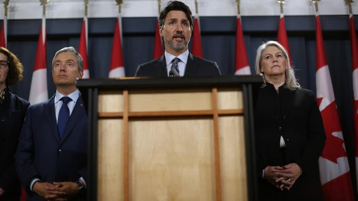 Canadian Minister of Foreign Affairs François-Philippe Champagne (L) and Deputy Minister of Defense Jody Thomas (R) listens as Prime Minister Justin Trudeau C) speaks during a news conference on January 11, 2020 in Ottawa, Canada. (AFP)