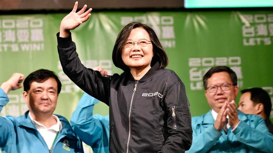 Taiwan's President Tsai Ing-wen (C) waves to supporters outside her campaign headquarters in Taipei on January 11, 2020. (AFP)