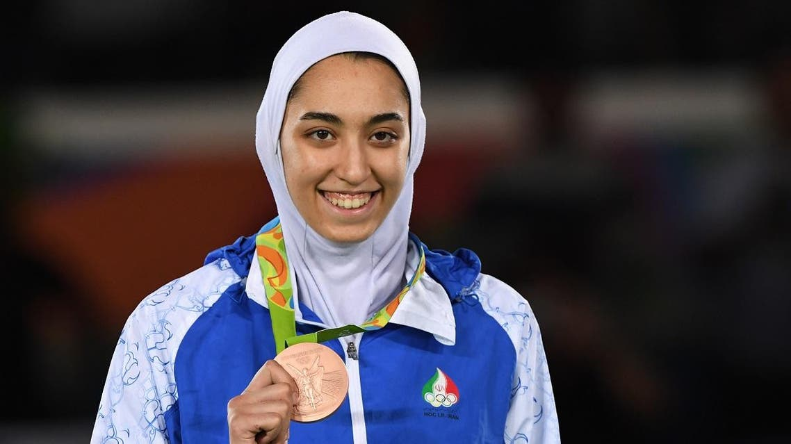 Iran's Kimia Alizadeh Zenoorin poses with her bronze medal on the podium after the women's taekwondo event in the -57kg category as part of the Rio 2016 Olympic Games, on August 18, 2016, at the Carioca Arena 3, in Rio de Janeiro.(AFP)