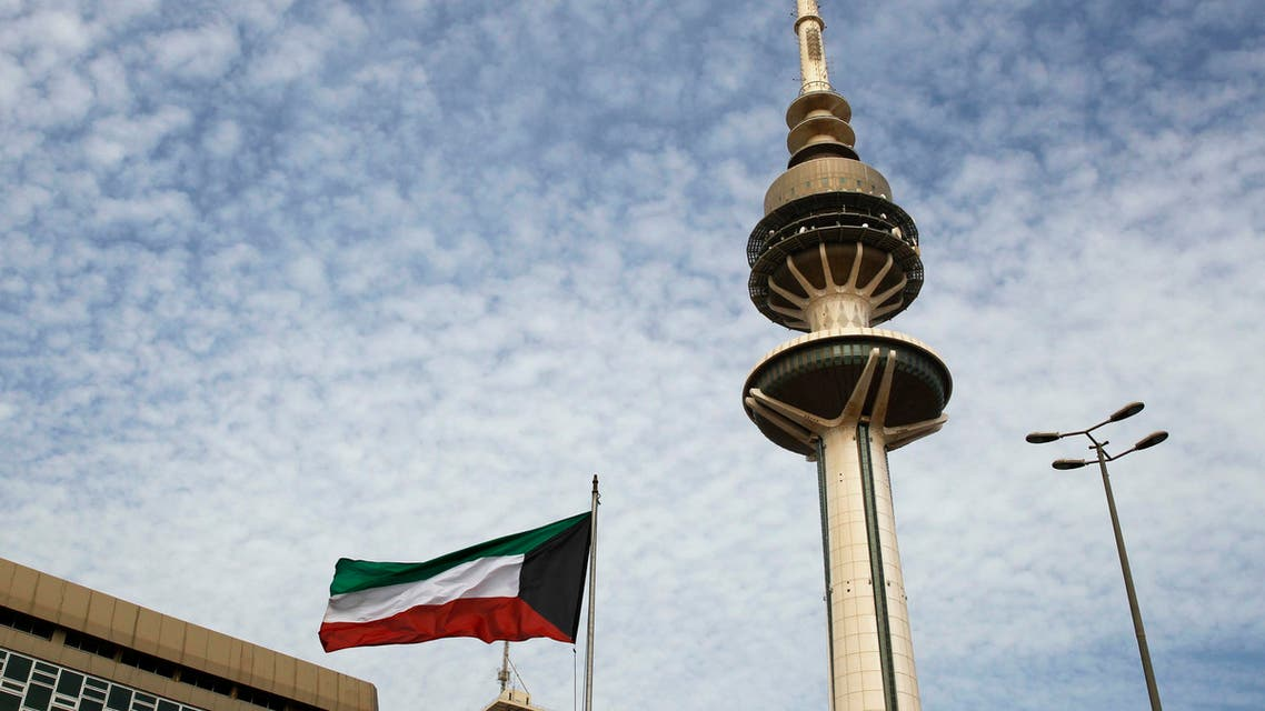 Kuwait's Liberation Tower is seen near a Kuwaiti flag in Kuwait City, Kuwait. (AP)