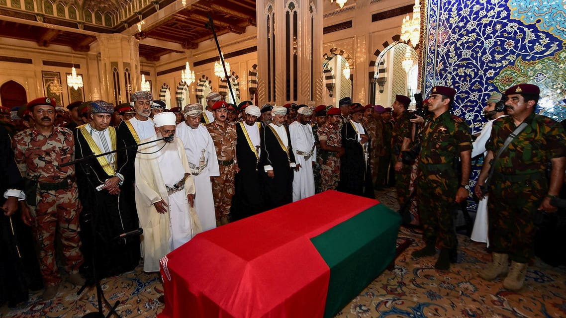 Oman's newly sworn-in Sultan Haitham bin Tariq al-Said prays with mourners next to the coffin of the late Sultan Qaboos in Muscat. (Reuters)