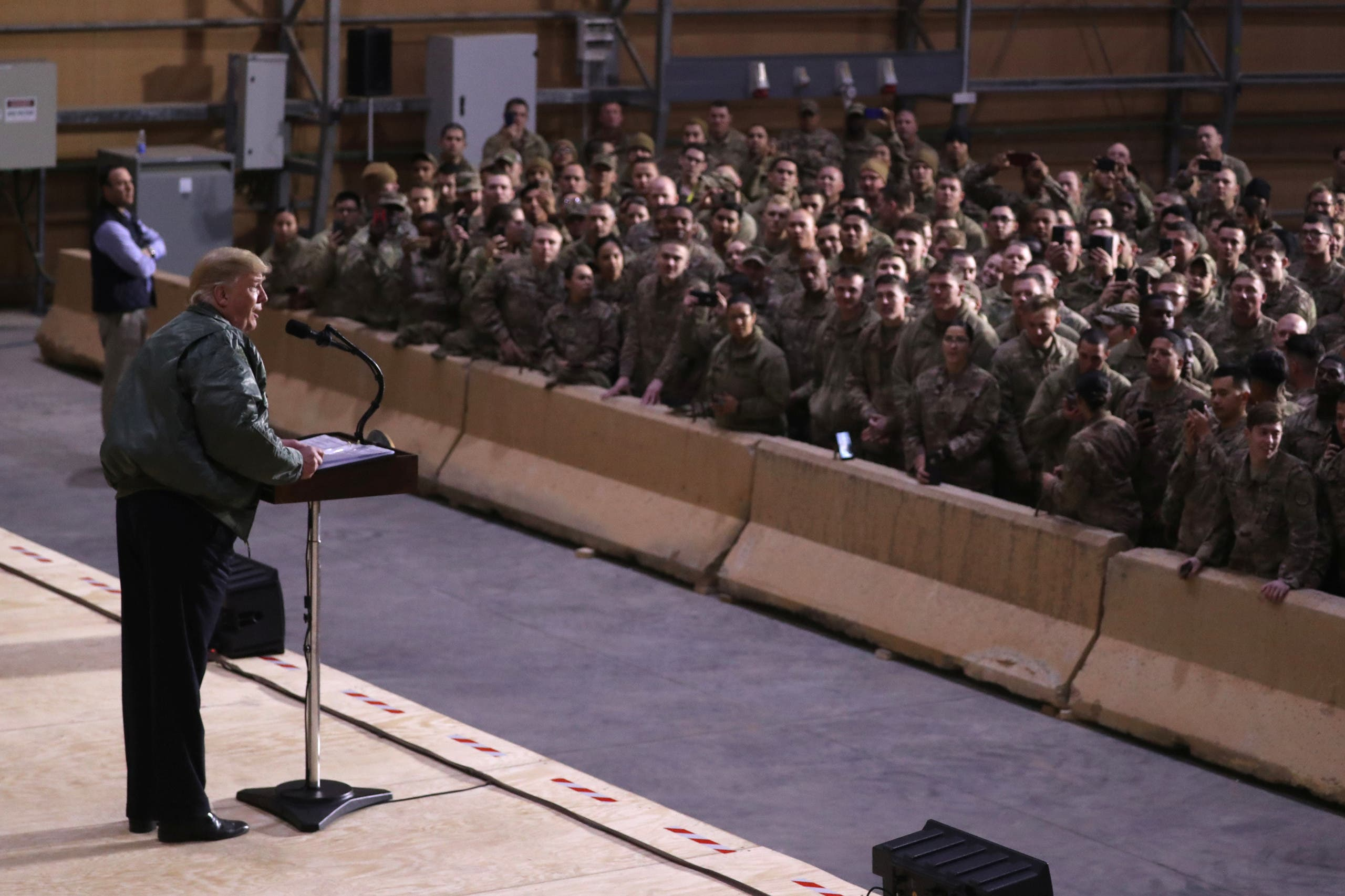 US President Donald Trump delivers remarks to US troops in an unannounced visit to Al Asad Air Base, Iraq December 26, 2018. (File photo: Reuters)