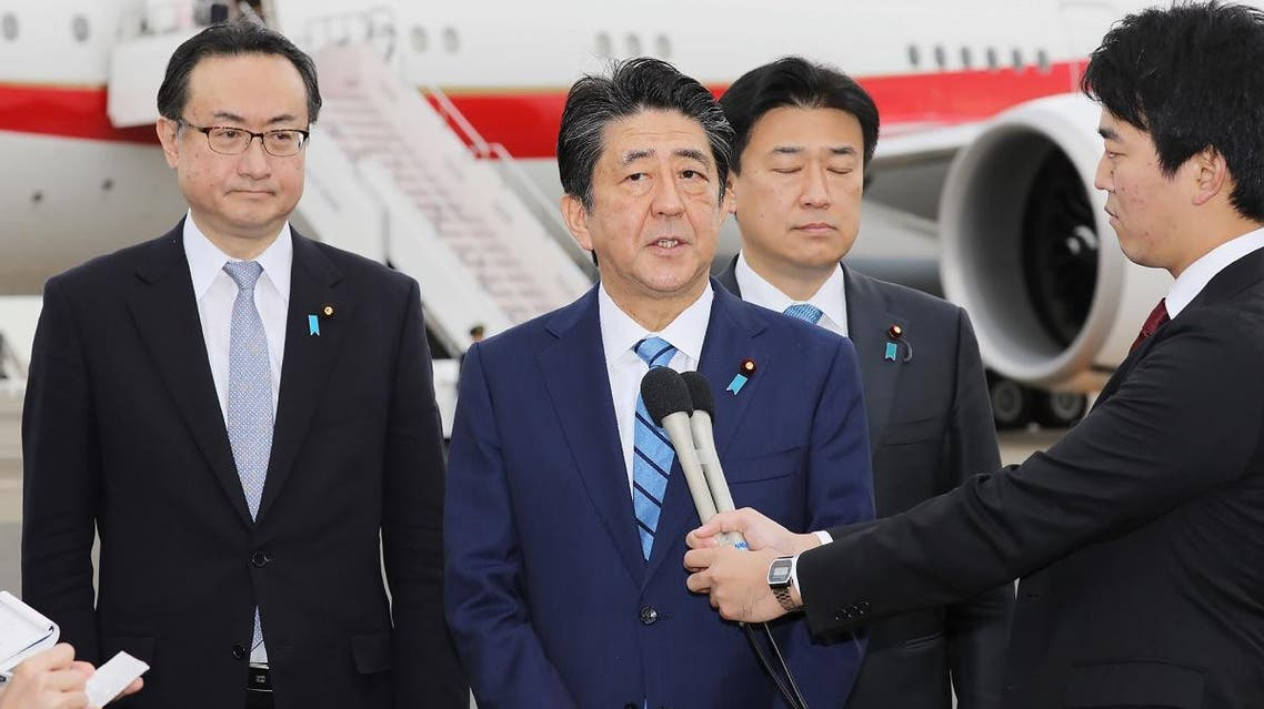 Japanese Prime Minister Shinzo Abe (C) speaks to the media before his departure at Tokyo's Haneda airport on January 11, 2020 for a five-day visit to the Middle East. (AFP)