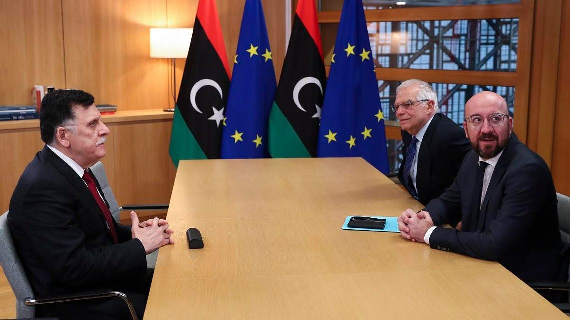 Libyan Prime Minister Fayez Al-Sarraj (L), speaks with European Council President Charles Michel (R) and European Union foreign policy chief Josep Borrell (C) during their meeting at the Europa building in Brussels, on January 8, 2020. (AFP)
