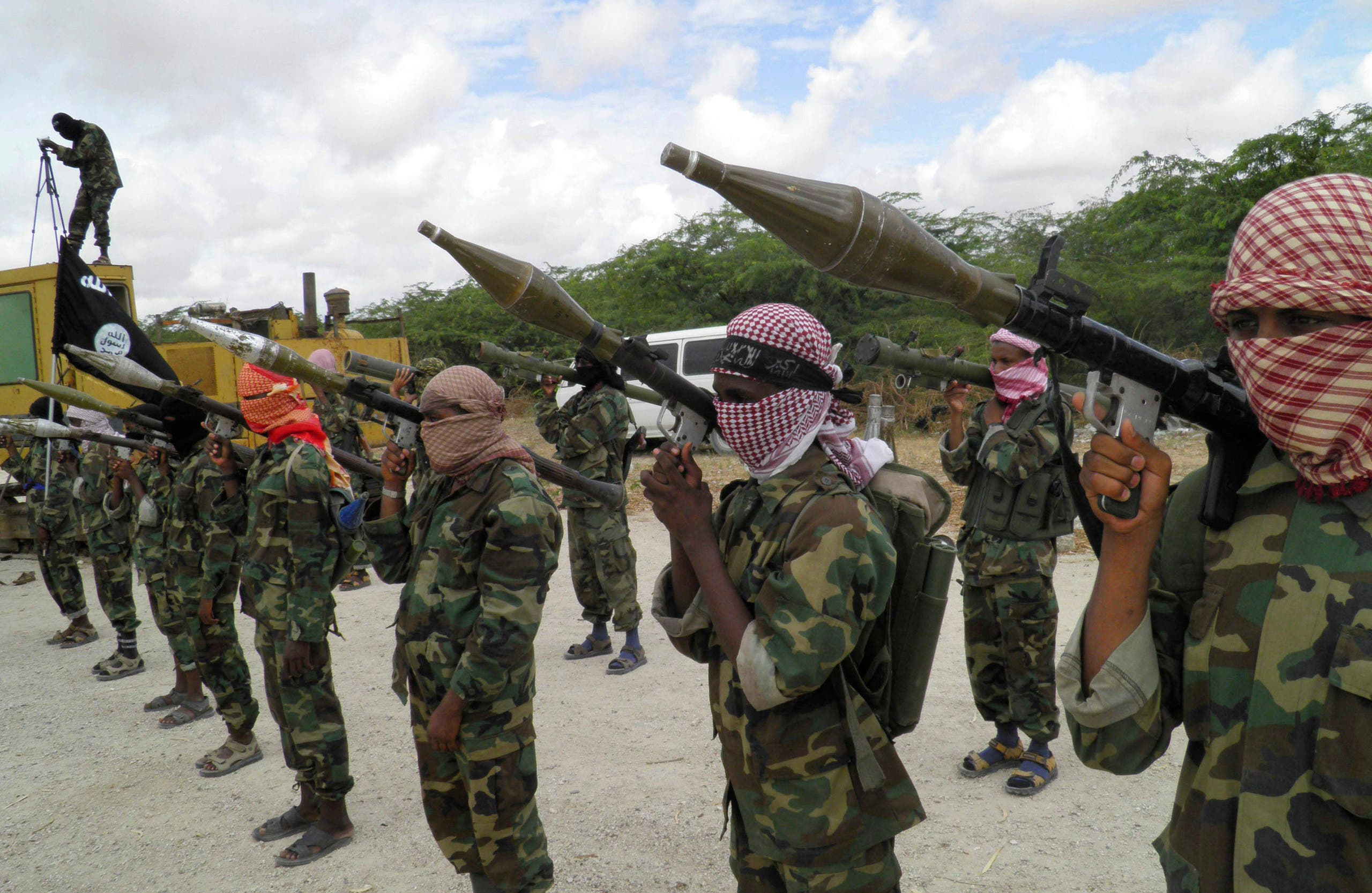 A file photo shows al-Shabaab fighters display weapons as they conduct military exercises in northern Mogadishu, Somalia. (AP)