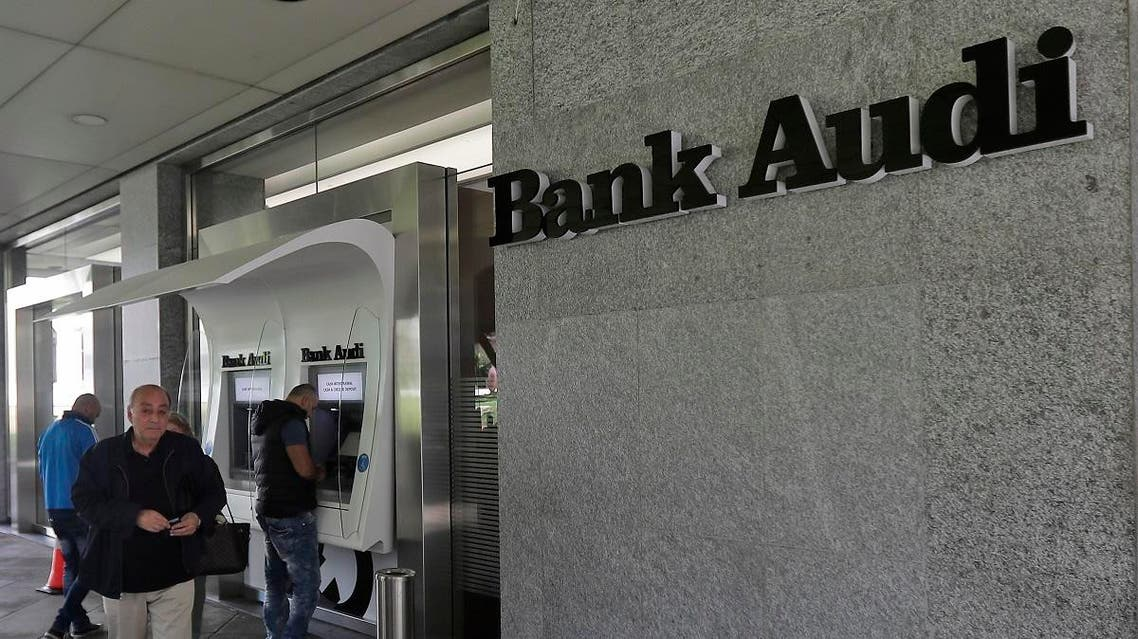 People use automatic teller machines (ATM) at Bank Audi in the centre of the Lebanese capital Beirut on November 19, 2019. (File photo: AFP)