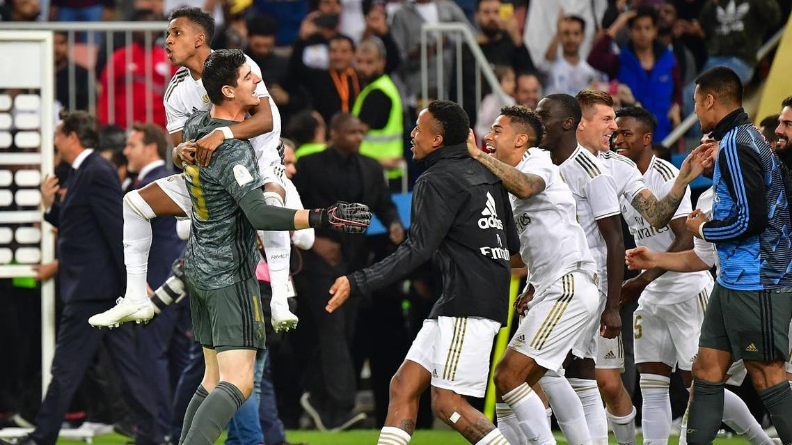 Real Madrid players celebrate winning the Spanish Super Cup final between Real Madrid and Atletico Madrid on January 12, 2020, at the King Abdullah Sports City in the Saudi Arabian port city of Jeddah. (AFP)
