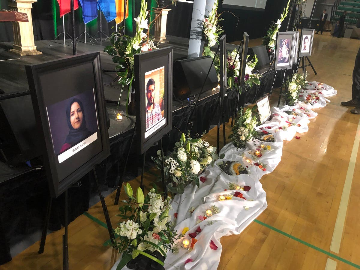 Photos of the victims are seen before the start of a memorial service for the Ukrainian Airlines flight PS752 victims, at the Saville Community Sports Centre in Edmonton, Canada, on January 12, 2020. (AFP)