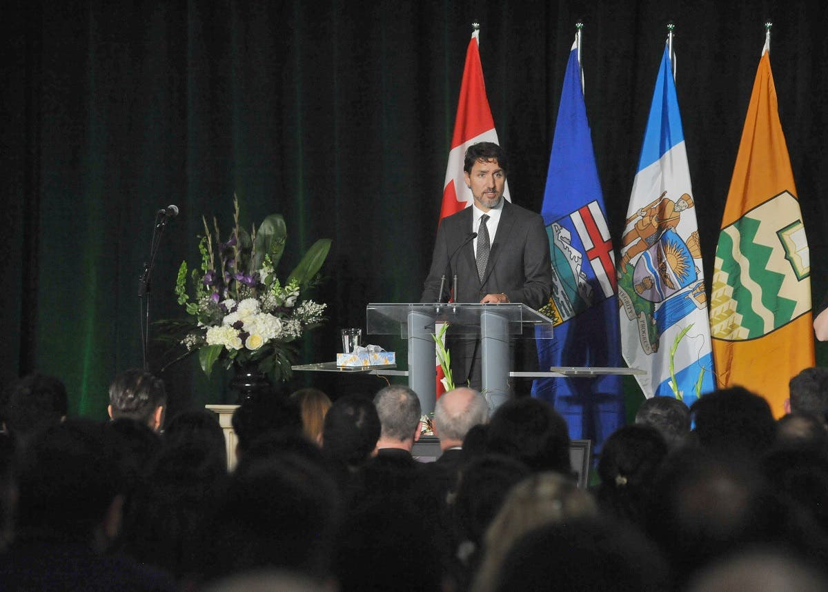 Canadian Prime Minister Justin Trudeau speaks at a memorial service for the victims of the Ukrainian Airlines flight PS752 crash in Iran at the Saville Community Sports Centre in Edmonton January 12, 2020. (AFP)
