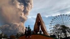 Lava gushes from Philippine volcano as ash spreads to Manila