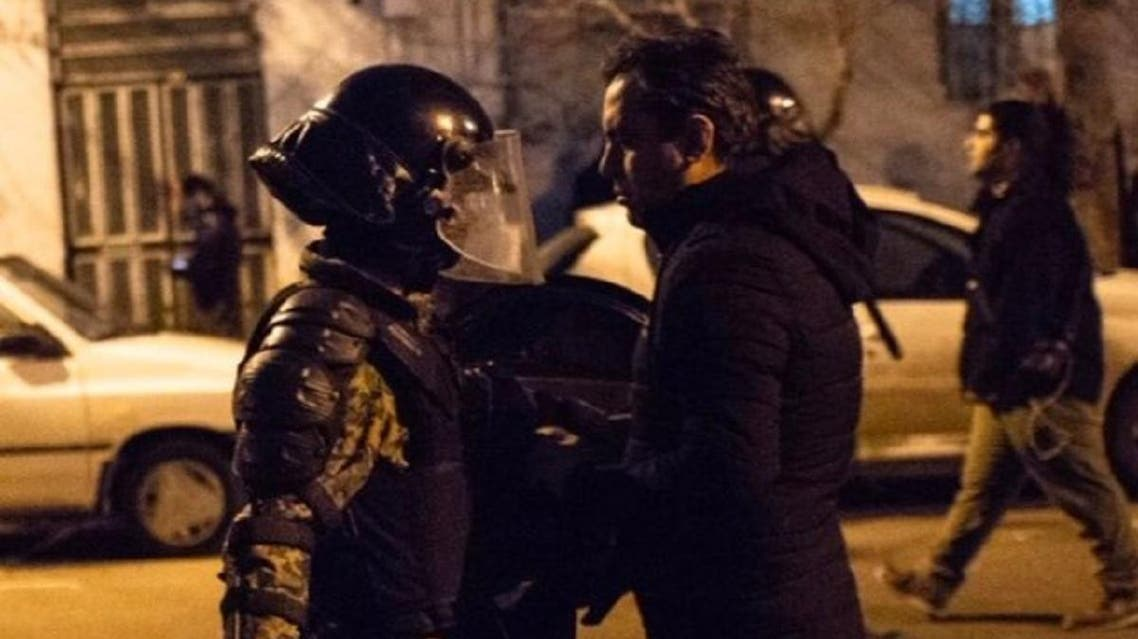 A photo taken on January 12, 2020 during protests in Iran shows a protester coming face to face with a police officer. (PhotoL: Twitter)