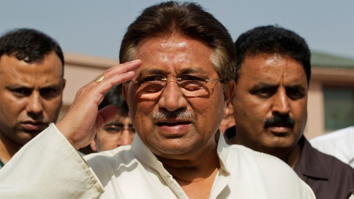 FILE PHOTO: Pakistan's former President and head of the All Pakistan Muslim League (APML) political party Pervez Musharraf salutes as he arrives to unveil his party manifesto for the forthcoming general election at his residence in Islamabad April 15, 2013. REUTERS/Mian Khursheed/File Photo