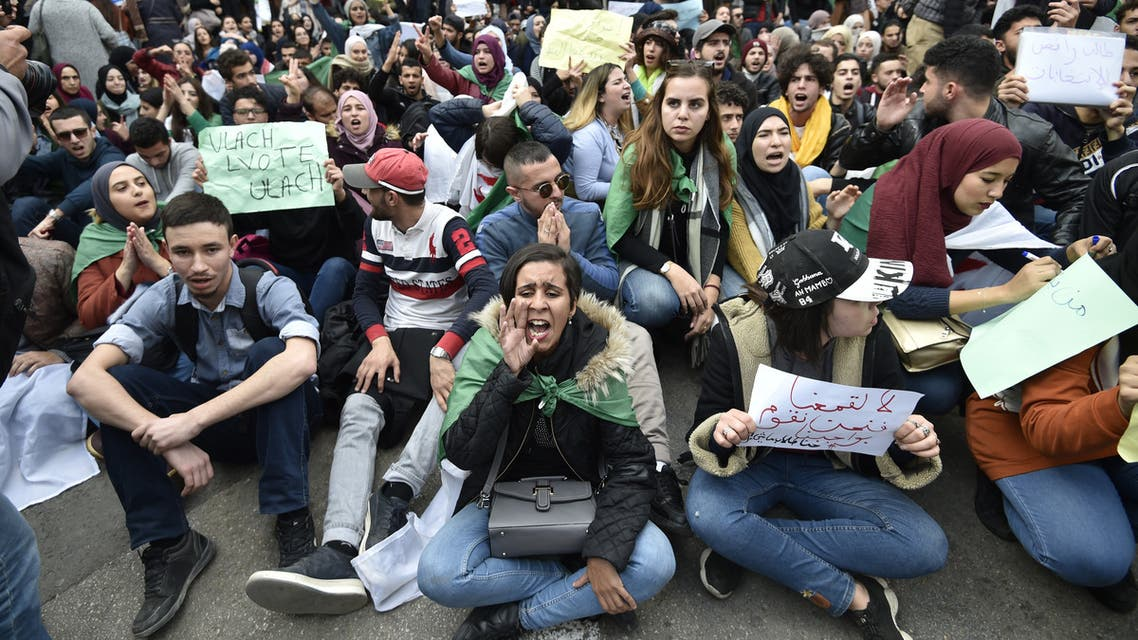 Algerian students shout slogans during an anti-government demonstration in the capital Algiers on December 9, 2019, ahead of the presidential vote scheduled for December 12. Algeria's contentious presidential election campaign is highlighting the vast gap between youth at the heart of a reformist protest movement and an ageing elite they see as clinging to power. The poll will see five candidates, all linked to ex-president Abdelaziz Bouteflika, compete for the top office. But protesters, whose mass mobilisation forced the ex-strongman to resign from his two-decade tenure in April, have rallied weekly to say sweeping reforms must come ahead of any vote.