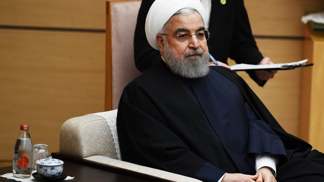 Iranian President Hassan Rouhani attend a meeting with Japanese Prime Minister Shinzo Abe (not pictured) at the prime minister's office in Tokyo on December 20, 2019.
