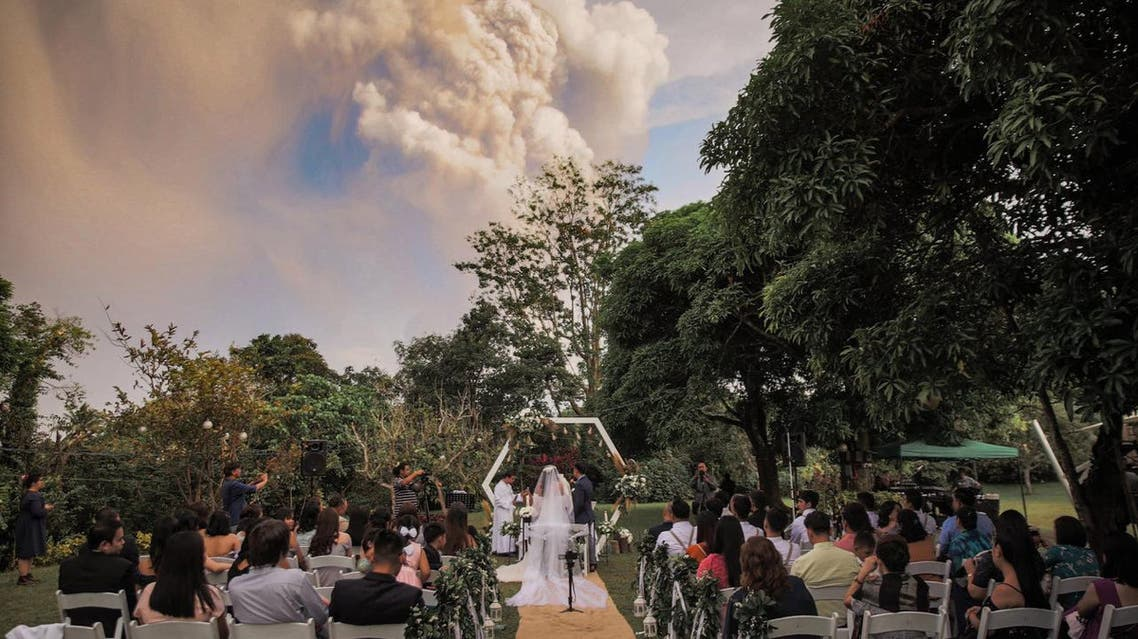 Picture depicting a Filipino couple getting married in-front of the live Taal volcano. (via Twitter)