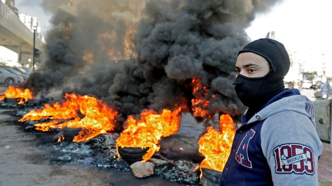 Lebanese anti-government protesters burn tires during a demonstration in the northern city of Tripoli on January 14, 2020 to denounce the political deadlock and a crippling economic crisis. Although protests have declined in size, demonstrations have been ongoing since October, increasingly targeting banks and state institutions blamed for driving the country towards collapse.