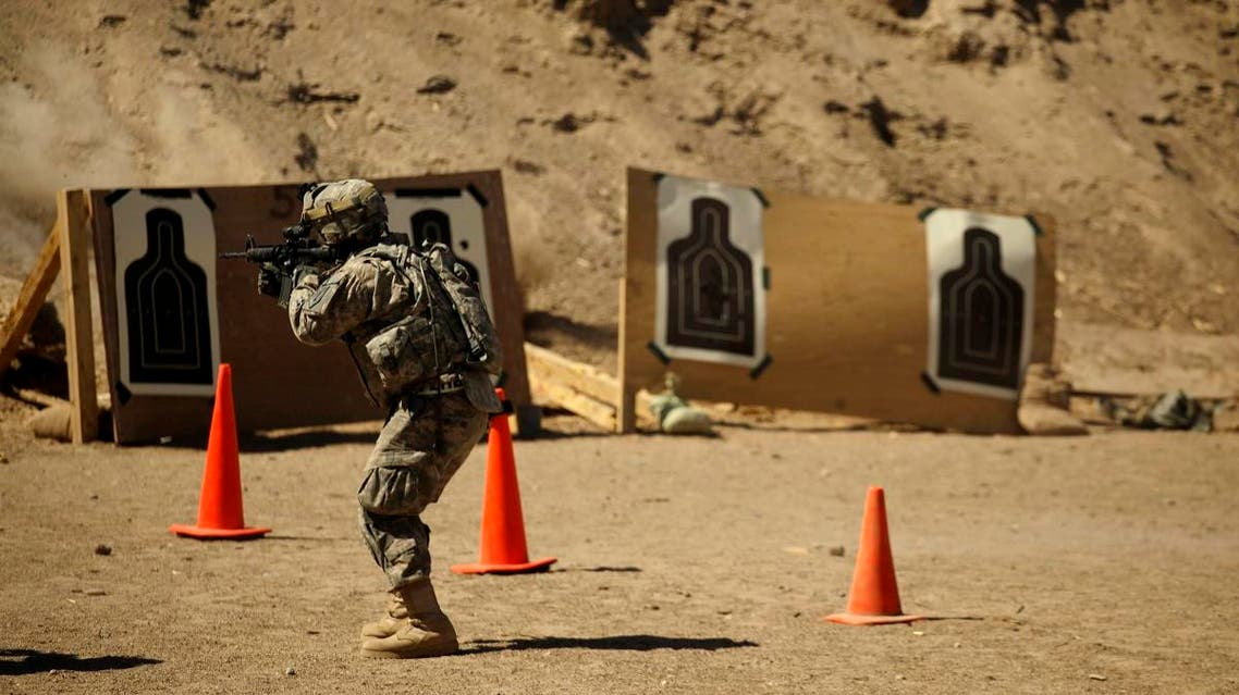 In this photo taken Thursday, March 17, 2011, a U.S. Army soldier from A Co., 1st Battalion, 18th Infantry Regiment, 2nd Brigade, 1st Infantry Division fires his weapon at a range at Camp Taji, north of Baghdad. (File photo: AP)