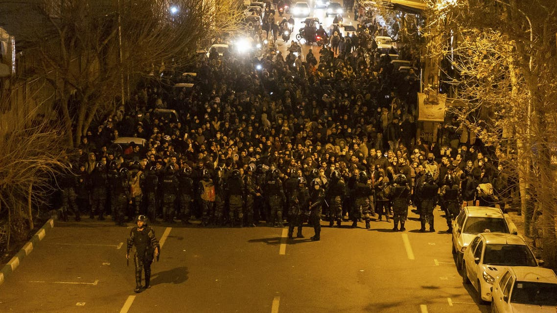 Iranian riot police stand guard as protesters gather in front of Tehran's Amir Kabir University on January 11, 2020. (AFP)