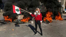 Lebanese anti-government protesters block roads again