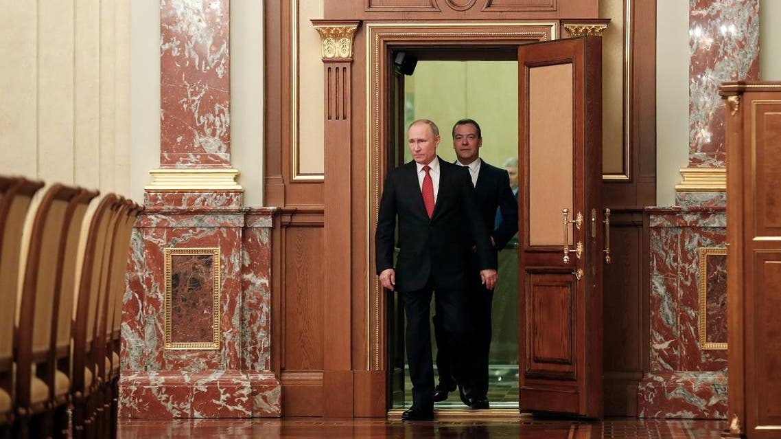 Russian President Putin and Prime Minister Medvedev attend a meeting with members of the government in Moscow. (Reuters)