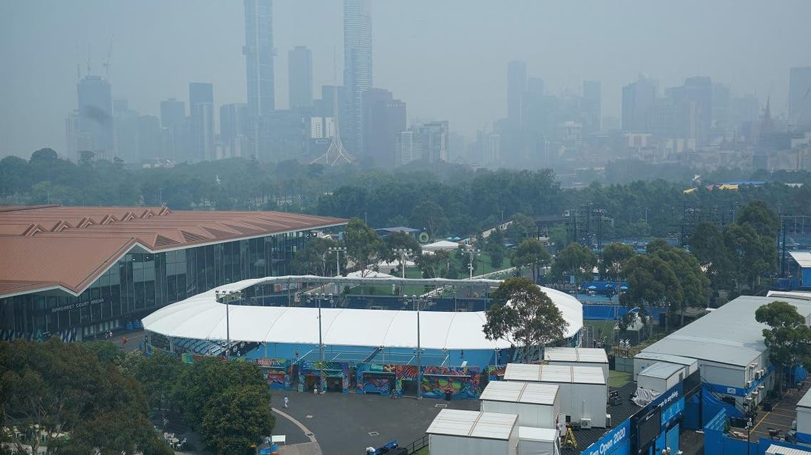 A general view of the city skyline shrouded by smoke haze from bushfires during an Australian Open practise session at Melbourne Park in Melbourne. (Reuters)