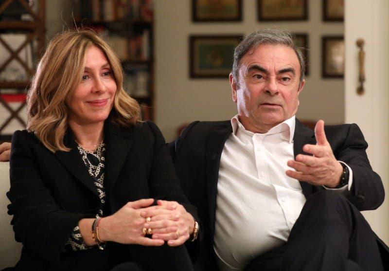 كارلوس غصن وزوجته(رويترز)