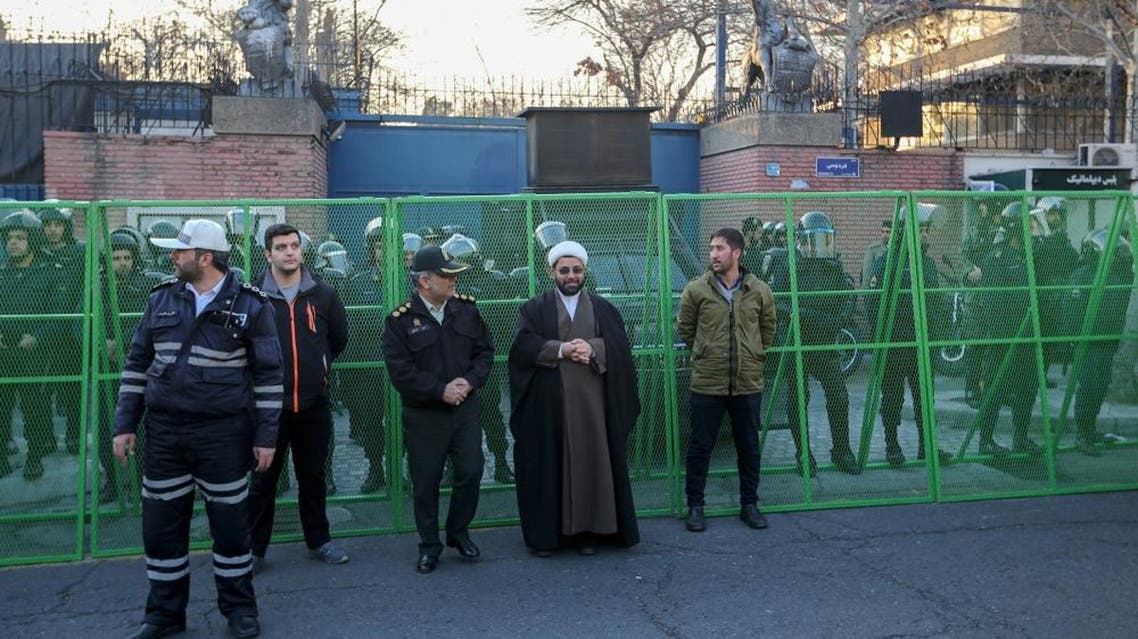 Iranian security forces stand guard in front of the British embassy in the capital Tehran on January 12, 2020 during demonstrations following the British ambassador's arrest. AFP