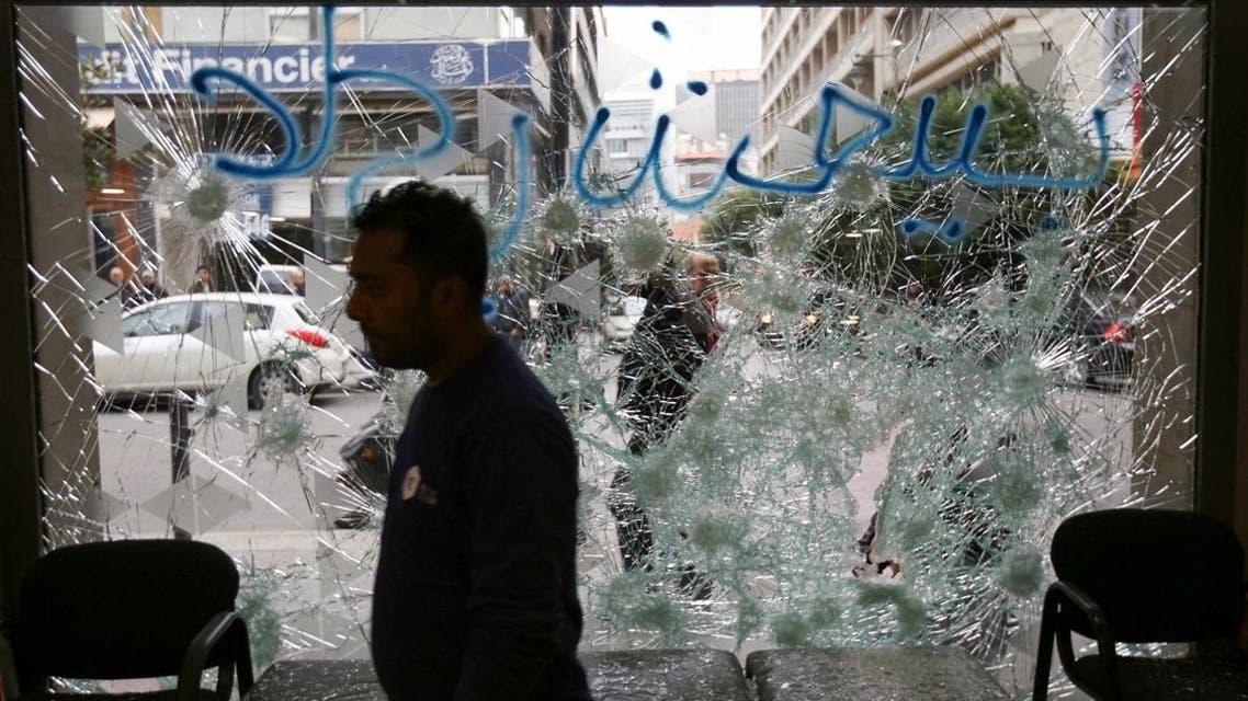 A man stands near a broken facade of a bank in Beirut, Lebanon, January 15, 2020. (Photo: Reuters)