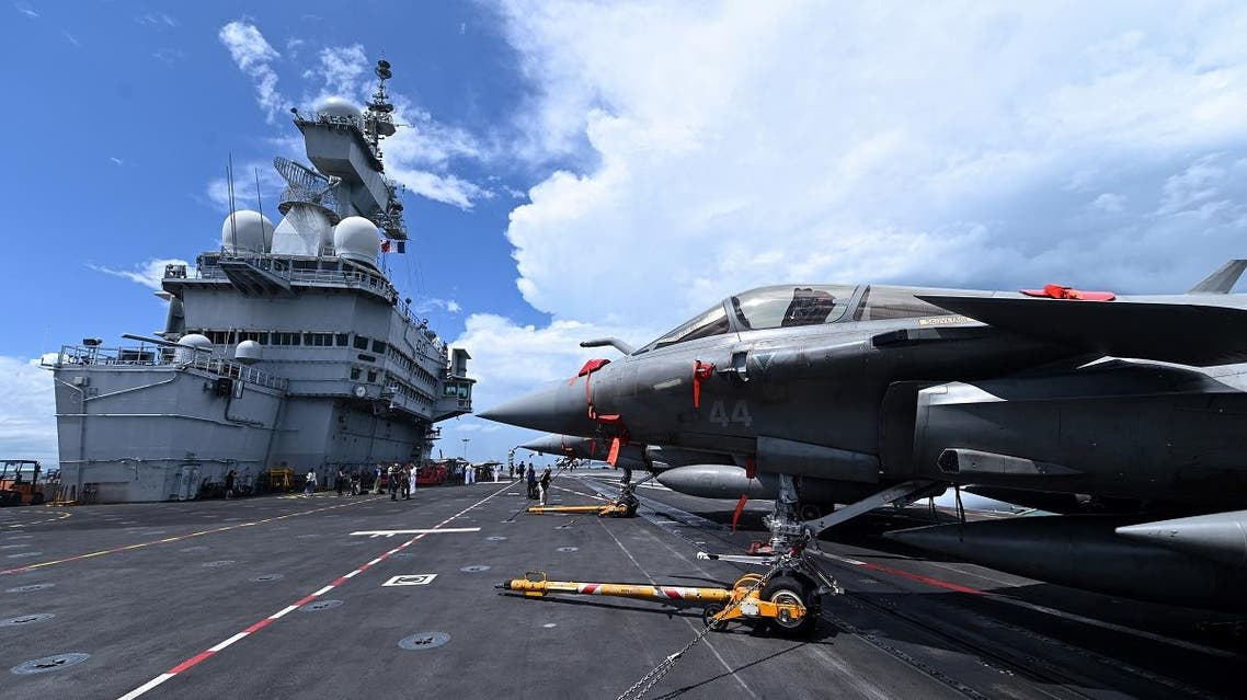 France's fighter jets Rafale are seen parked on the flight deck of the French aircraft carrier Charles de Gaulle during a media tour at Changi Naval Base in Singapore on May 28, 2019. (AFP)