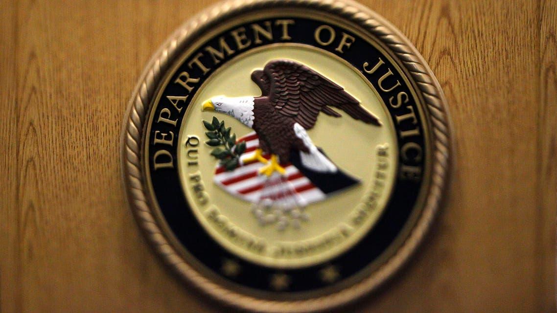 Department of Justice logo (AP)